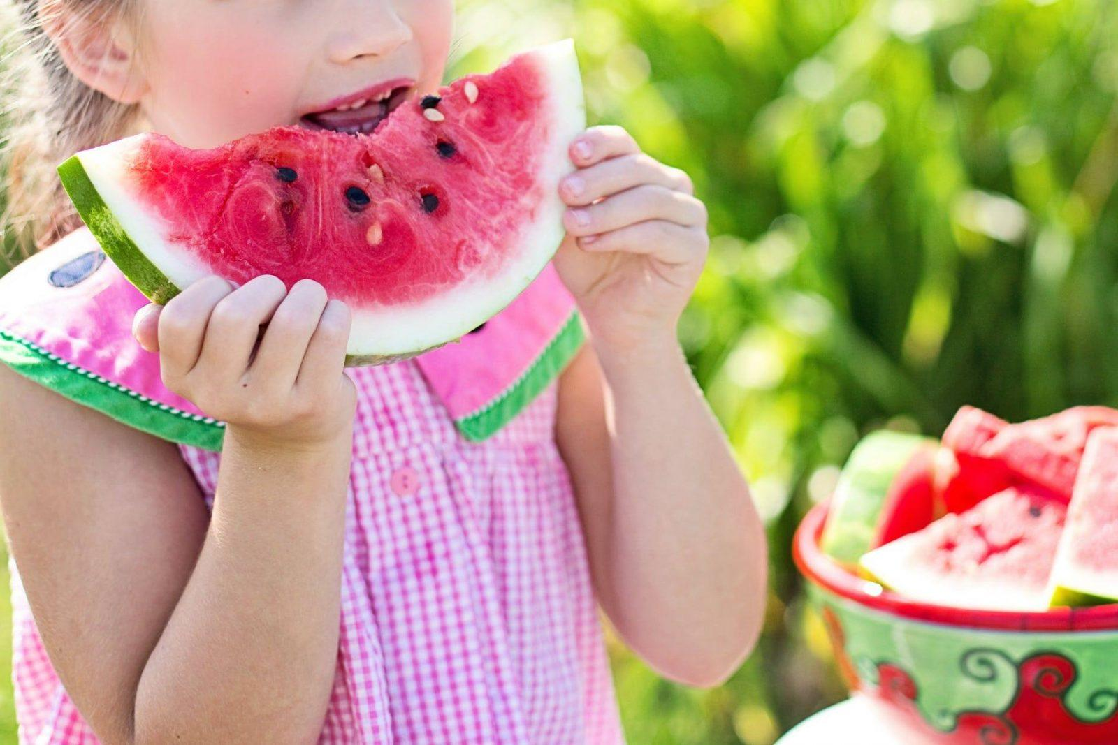 Child Eating A Watermelon